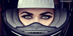 Striking eyes peering out from a full face helmet. Photo by Cocographie.