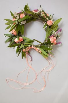 DIY floral crown here: http://www.weddingchicks.com/2014/06/16/this-diy-crown-is-a-must-for-your-flower-girl/