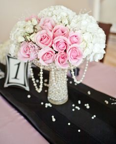 incorporate white lillies and the pink roses. Make into bridal flowers