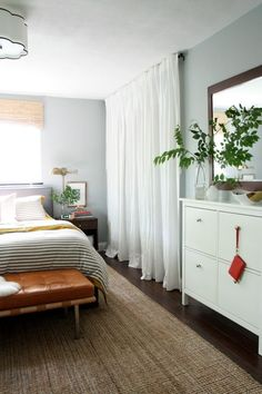 Love how they ditched the closet doors in favor of curtains hung high and wide in this bedroom. This would also work really well for our laundry nook in the upstairs hallway.