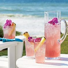Cranberry juice lends a pinkish tint to this cocktail and contributes to its name—Pink-a-Colada. Brighten up this refreshing beverage with fresh fruit and edible flowers.