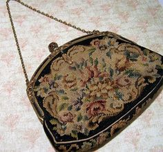Vintage Art Deco Czech floral petite point purse Decorative etched gold tone frame with black enamel and faceted black stones. Small dangle at clasp, and the clasp is a filigree ball Black background with multi color flowers I see no damage to the fabric Pink grosgrain lining is in good vintage condition, there are a few very minor marks Perfect for a vintage style bride, this is an amazing piece Unsigned, I have a very similar bag with Made in Czechoslovakia label 6 1/4 wide, 4 1/2...