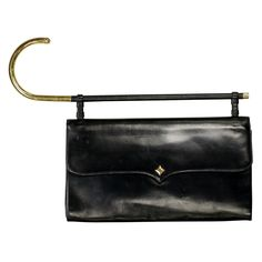 Koret Black Calfskin Umbrella Handle Purse | From a collection of rare vintage handbags and purses at http://www.1stdibs.com/fashion/accessories/handbags-purses/