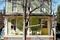 Full image of yellow door of green house