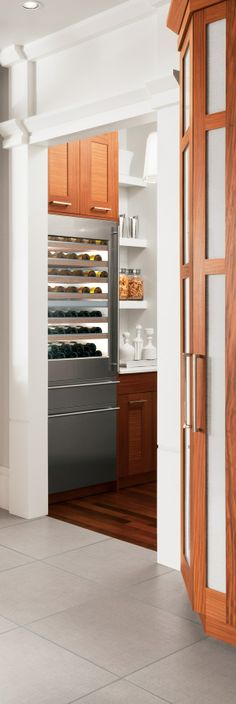 Integrated wine reserves are always a good idea. #Kitchen #Storage