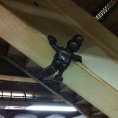 Hang in there!  (Sculpture in 14th St train station, NYC)