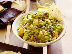 Get this all-star, easy-to-follow Charred Corn Guacamole with Corn Chips recipe from Bobby Flay.