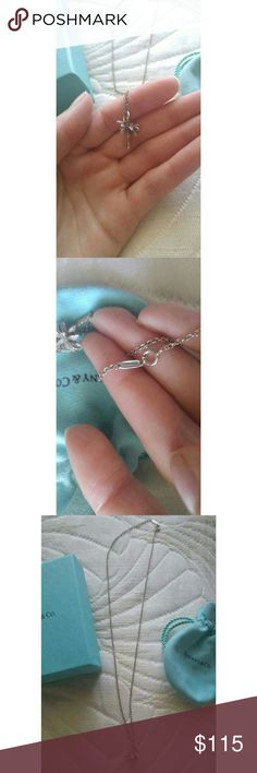 TIFFANY & CO. NECKLACE WITH CHARM UPDATED PICS! Shined & Polished! PRICE IS FIRM (NEW CONDITION + Posh takes out a big percentage of my earnings) -Genuine sterling silver Tiffany & Co. Necklace w/ palm tree charm -Retails for $175 -Worn once, Perfect condition -NWOT  -18 inch chain length -Original blue box, pouch, and ribbon included -NO SWAPS -Ships within 2 days Tiffany & Co. Jewelry Necklaces