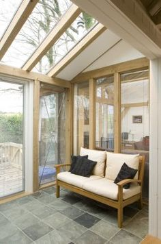 Small glazed oak sun room in Tin house on Dartmoor, by Roderick James Architects
