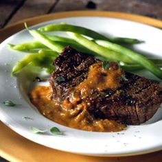 Grilled Filet Mignon with Blackend Tomato and Oregano Sauce. Tomatoes are charred under a broiler, then mixed into a terrific sauce to top grilled beef tenderloin.