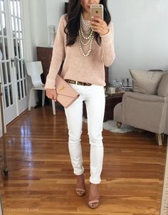 Easy spring outfit: white jeans, casual sweater, statement necklace, convertible bag - more outfit ideas at extrapetite.com