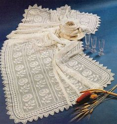 Crochet tablecloth pattern with rose motif. More Great Patterns Like This