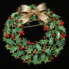 """Gold tone metal and enamel Christmas wreath pin. The pin closes with a safety clasp. Condition is very good to excellent. This Christmas wreath pin is hallmarked Weiss. It measures 2"""" x 2 1/8."""""""