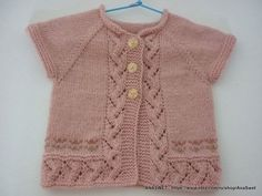 Pink cardigan has top-down raglan construction and is worked in one piece.Knitting is soft and pleasant to the touch. The cardigan no edges. length - 28