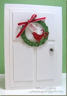 This is ADORABLE. Love the little wreath. This door would be super easy to make.
