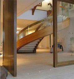 Escada helicoidal http://conexaodecor.com/2016/11/1001-degraus-escadas/