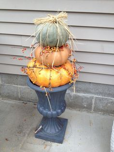 Pumpkin tower for the front porch. Acorn Wreath, Holiday Decorating, Fall Pumpkins, Front Porch, Planter Pots, Tower, Thanksgiving, Wreaths, Holidays