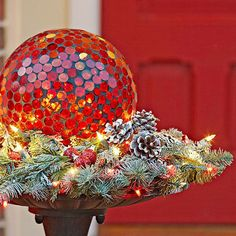 Save storage space by transitioning summer decor into festive holiday decorations instead of hiding it away! Get the birdbath revamp details here: http://www.bhg.com/christmas/outdoor-decorations/holiday-inspired-outdoor-decorating-that-lasts/?socsrc=bhgpin010115birdbathrevamp&page=6