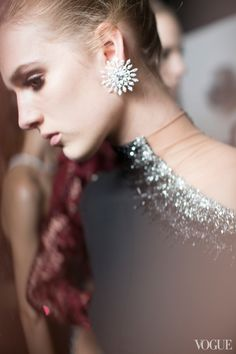 Snowflake star earring backstage at Versace Fall 2013 Couture