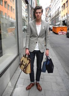 Grey suit jacket with dark jeans is casual yet smart enough for everyday wear. Take it from the office to the street with ease.