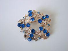 https://www.etsy.com/listing/167405643/1950s-sky-blue-sapphire-blue-rhinestone