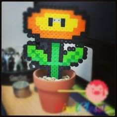 Mario Fire Flower pot. $18.00, via Etsy.  Seller is PixelCloset, based out of Perth, Australia