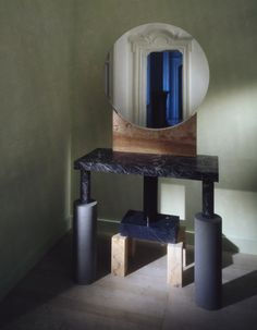 "Ettore Sottsass, Bharata, Specchio Rotondo | Side table with mirror in marble and ""serena"" stone"