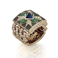 Giampiero Bodino Rosa dei Venti ring set with a central sugarloaf sapphire, emeralds and black diamonds on a diamond-encrusted chain.