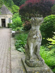 Tara Dillard: dog, axis, enfilade, focal point, summer house, flowering shrub border, stone, plinth, Iford Manor Great Terrace
