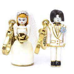 Juicy Couture Limited Ed Bride Groom Charm wedding Set $88.00  $51.99 Save: 41% off Retail price: $88 Condition:New in original jewelry box Main color: as pictured Closure: lobster clasp Material:14K gold plated brass More info  * limited edition 2011 * Nuptial couple styles a pair of charms sealed with the printed words 'I do' at their backs. * imported * clips to Juicy Couture starter bracelets or necklace (sold separately)