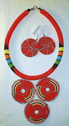 African Handmade Maasai Beaded Necklace pendant earrings set Red and other multicolored beads New. Handmade in Kenya, Africa. Pendant Earrings, Beaded Necklace, African Crafts, Rope Jewelry, Craft Markets, African Jewelry, Zulu, Pendant Set, Earring Set