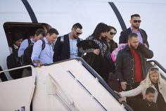 The Kansas City Royals landed at Kansas City International Airport Monday afternoon showing smiles on their faces after getting off the plane after beating the New York Mets in five games to win the World Series 2015 in New York.
