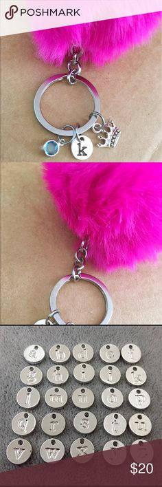 Pom Pom fur birthstone key chain Silver plated material. Faux fur material. Key chain comes with a letter and a crown. Let me know your letters from A to Z and birthstone Jewelry Bracelets