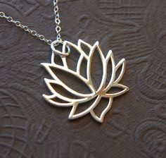 Large silver blooming lotus flower pendant necklace. $32.00, via Etsy.