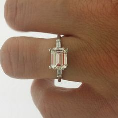 Stunning! I love everything about this ring, and could replace the diamond for Morganite and still be happy. 1.50 Center Emerald Cut Diamond with Straight Baguette Side Stones Shape