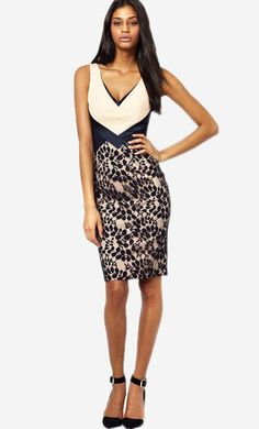 Made from a breathable stretch fabric. Plunge V-neckline. Contrast lace skirt overlay. Zip back fast...