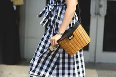 This Year, NYFW Street Style Is All About Minimalism #refinery29  http://www.refinery29.com/2016/09/120553/nyfw-spring-2017-best-street-style-outfits#slide-26  This basket bag would make Jane Birkin proud....
