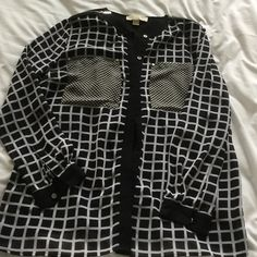 Michael Kors Sheer Blouse Black and white sheer blouse. Perfect for the office or dressed down with jeans. Michael Kors Tops Button Down Shirts