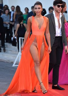 Imagination NOT required:Giulia Salemi put on a highly revealing display in her tangerine dress