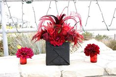 Larger black and red centerpieces by Rolland Glass, via Flickr   covered black crush paper