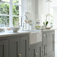 Grey simple kitchen, stone worktop and Belfast sink. Really like this. Think it would date well compared with ultra modern and more homely too.