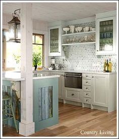 I like the cabinet colors in this kitchen.  Am I brave enough?