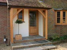 Oak door windows and porch replacement sash bay window in muswell hill Front Door Steps, Front Door Porch, Porch Doors, Side Porch, Porch Entrance, Oak Front Door, Front Porches, Front Door Overhang, Front Door Canopy