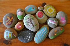Many versions of story stones on the internet and they are a great idea for fostering creativity and language development. Stones painted by hand in acrylic paint.  Simple shapes and patterns.   These are beautiful from - Paint On The Ceiling.