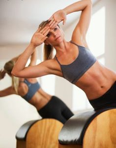 Side raises for oblique workout. This looks a lot better than using a stability ball. Think I'll make me one :)