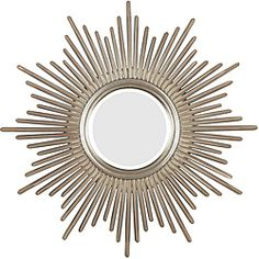 Bursting with regal style, this mirror is hand-finished in antique silver with warm highlights to adapt to any decor.