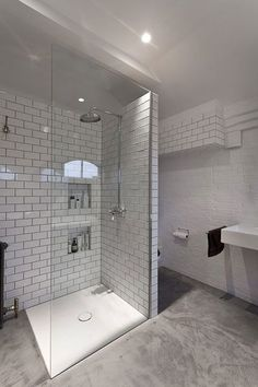 A bathroom in a Victorian school conversion in SE1, London, has been transformed into beautiful space with an internal Crittal window looking onto the bedroom. Photographer's credit: Simon Maxwell