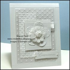 White on White Textural wedding card with flower accent