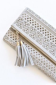 Y'all. We are OB-SESSED with clutches here at Page 6, for so many reasons! They are the perfect dainty addition to any outfit, dressy or casual! Our Kendall Perforated Clutch fits all of your necessit