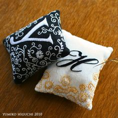 Yumiko Higuchi embroidery —ピンクッション2 — These are such pretty pincushions! Wouldn't they be beautiful as pillows?